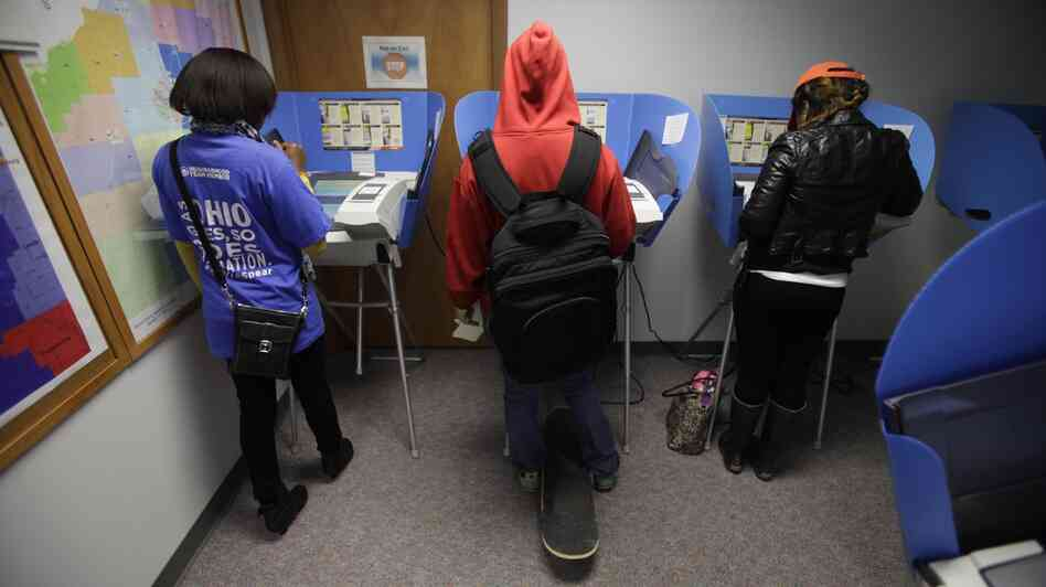Voters cast their ballots during early voting in Bowling Green, Ohio. Early voting began Oct. 2 in the battleground state, five weeks before Election Day on November 6.