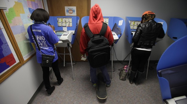 Voters cast their ballots during early voting in Bowling Green, Ohio. Early voting began Oct. 2 in the battleground state, five weeks before Election Day on November 6. (Getty Images)
