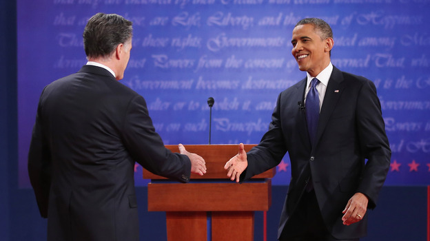 President Obama and Republican challenger Mitt Romney greet one another before Wednesday's debate in Denver. (Getty Images)
