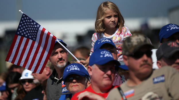 Supporters watch Republican presidential candidate Mitt Romney speak on Friday in Abingdon, Va. Romney started off his campaign calling for big tax cuts, but has backed off that somewhat. (Getty Images)