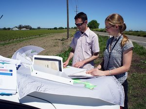 Historical ecologists Alison Whipple and Robin Grossinger study maps in California's delta, just east of San Francisco Bay.