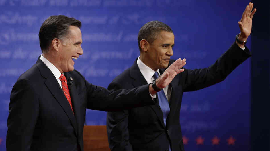 Mitt Romney and President  Obama wave to the audience during the first presidential debate at the University of De