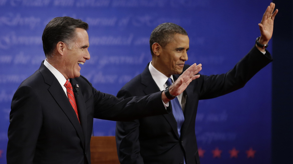 Mitt Romney and President  Obama wave to the audience during the first presidential debate at the University of Denver, on Wednesday. (AP)