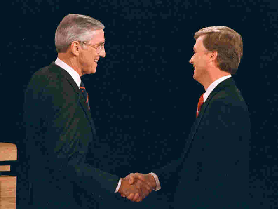 Sen. Lloyd Bentsen (D-Texas) shakes hands with Sen. Dan Quayle (R-Ind.) before their vice presidential debate at the Omaha Civic Auditorium in Omaha, Neb., on Oct. 5, 1988.