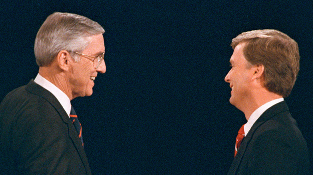 Sen. Lloyd Bentsen (D-Texas) shakes hands with Sen. Dan Quayle (R-Ind.) before their vice presidential debate at the Omaha Civic Auditorium in Omaha, Neb., on Oct. 5, 1988. (AP)