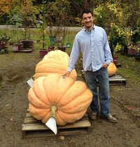 Topher Mallory stands next to the pumpkin he turned into a first-place-winning powerboat.