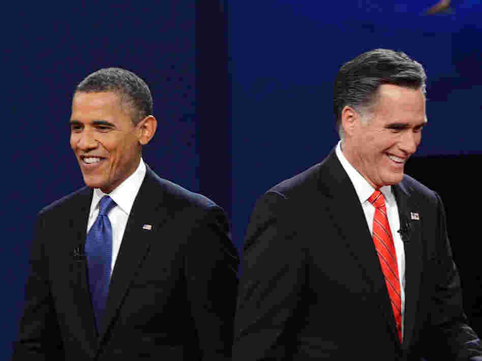 President Obama and Republican presidential candidate Mitt Romney finish their debate at the University of Denver on Oct. 3.