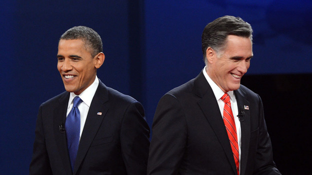 President Obama and Republican presidential candidate Mitt Romney finish their debate at the University of Denver on Oct. 3. (AFP/Getty Images)