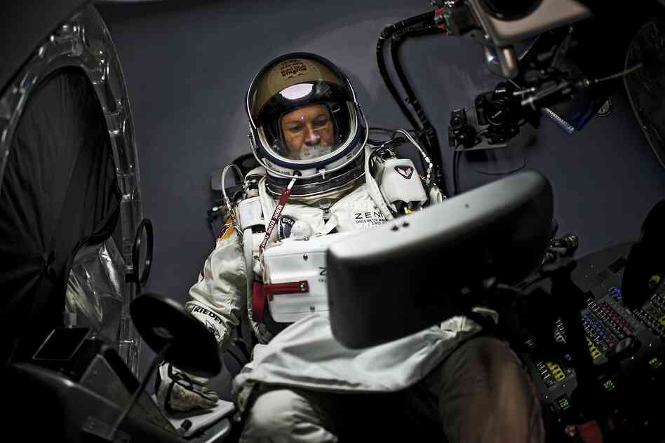Felix Baumgartner of Austria sits in his capsule during the