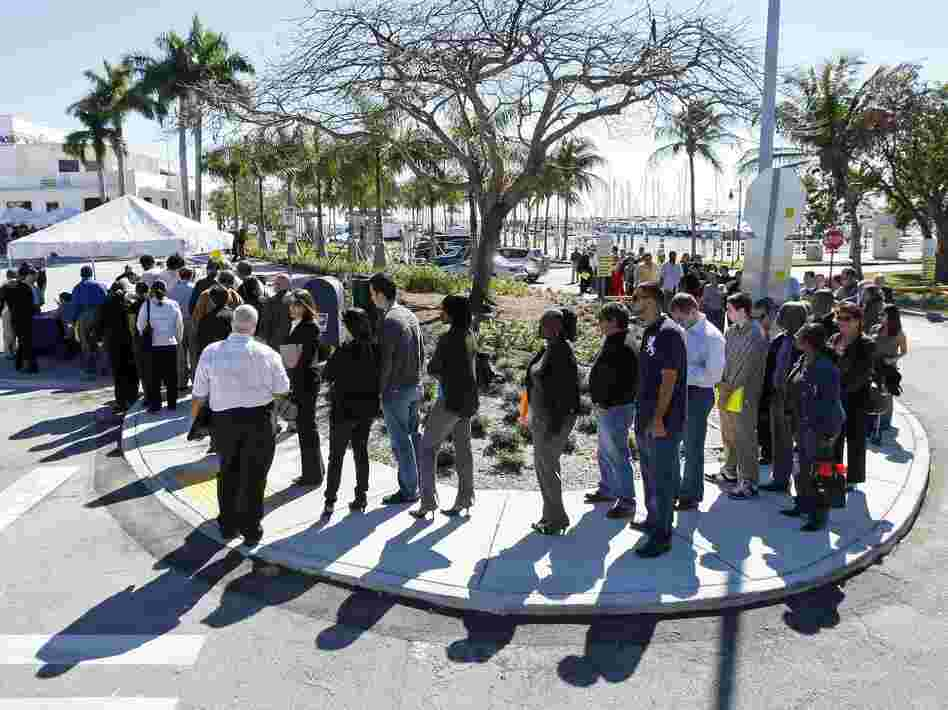 Job seekers line up to register at a Miami job fair in January. A new study shows that Florida voters discuss joblessness in ways quite different from those in Ohio and Virginia, two other presidential battleground states.