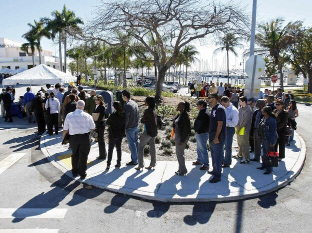 Job seekers line up to register at a Miami job fair in January. A new study shows that Florida voters discuss joblessness in ways quite different from those in Ohio and Virginia, two other presidential battleground states. (AP)