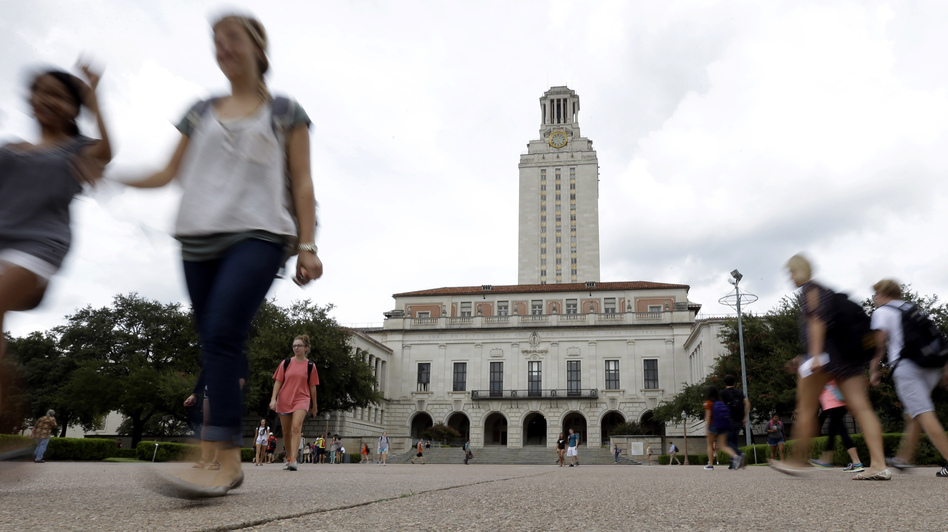 Students walk through the University of Texas, Austin, campus near the school's iconic tower on Sept. 27. (Eric Gay/AP)