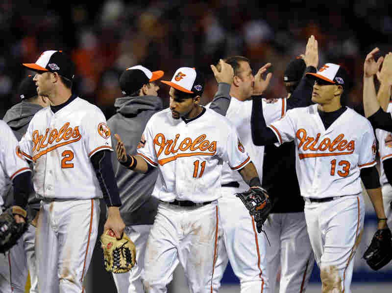 Baltimore Orioles Nate McLouth (from left), J.J. Hardy, Robert Andino and Manny Machado high-five teammates after Game 2 of Major League Baseball's American League Division Series against the New York Yankees. Somewhere, commentator and Orioles fan Frank Deford is also giving high-fives.