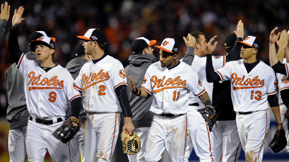 Baltimore Orioles Nate McLouth (from left), J.J. Hardy, Robert Andino and Manny Machado high-five teammates after Game 2 of Major League Baseball's American League Division Series against the New York Yankees. Somewhere, commentator and Orioles fan Frank Deford is also giving high-fives. (AP)