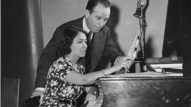 Clotilde Arias (seated) with composer and arranger Terig Tucci, circa 1943.