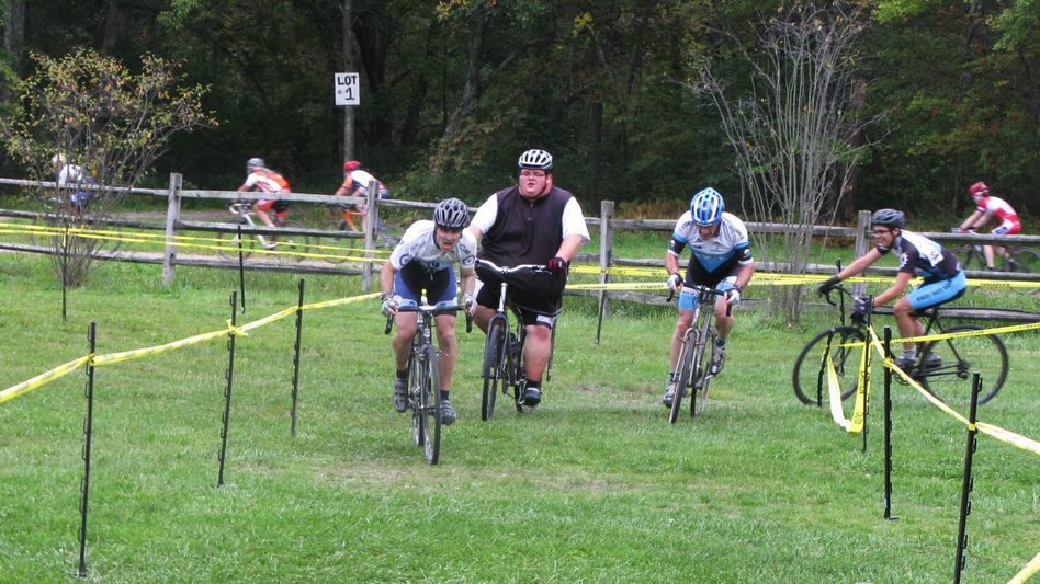 Ernest Gagnon competes in his first cyclocross race, the Midnight Ride of Cyclocross, on Sept. 26 in Lancaster, Mass. (New Hampshire Public Radio)