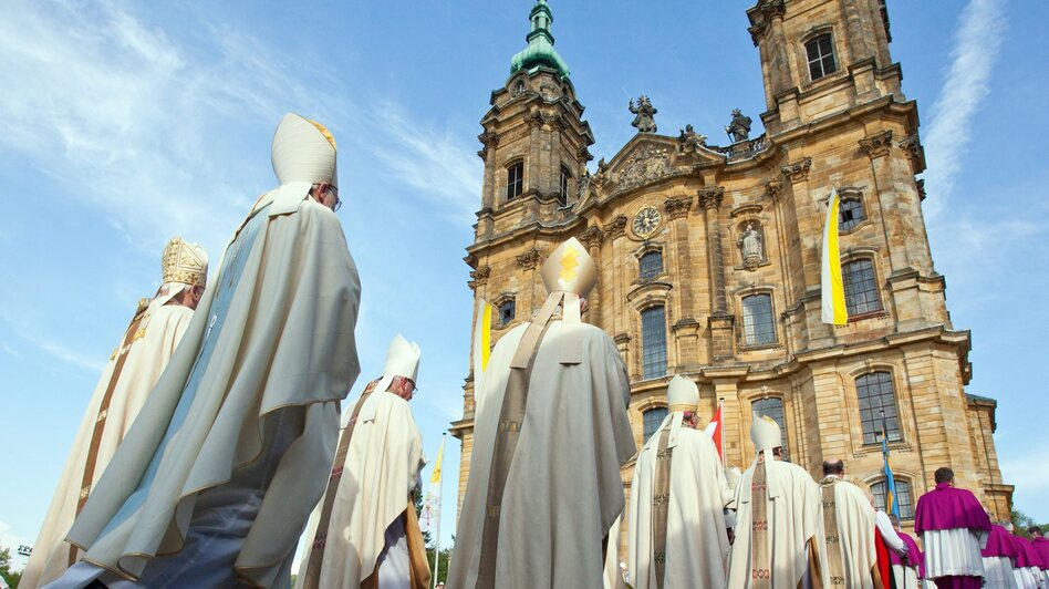 Bavarian bishops walk in a procession to the Basilica of the Fourteen Holy Helpers near Bad Staffelstein, Germany, in May. A decree by the German bishops' conference warns that German Catholics who do not pay a state church tax will be denied sacraments. (EPA/Landov)