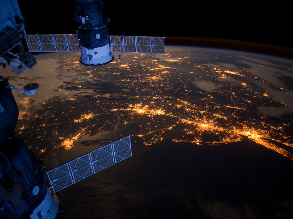 This nighttime photograph taken from the International Space Station shows much of the Atlantic coast of the United States. Parts of two Russian vehicles parked at the orbital outpost can also be seen in the frame. (NASA)