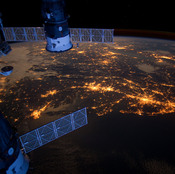 This nighttime photograph taken from the International Space Station shows much of the Atlantic coast of the United States. Parts of two Russian vehicles parked at the orbital outpost can also be seen in the frame.