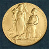 "The medal for the Nobel in Physics. According to the Nobel committee, the inscription reads: "" 'Inventas vitam juvat excoluisse per artes' loosely translated 'And they who bettered life on earth by their newly found mastery.' """