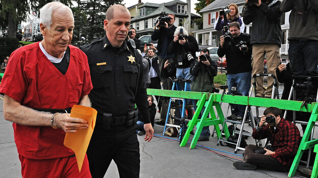Former Penn State assistant football coach Jerry Sandusky as he walked to the courthouse this morning in Bellefonte, Pa.