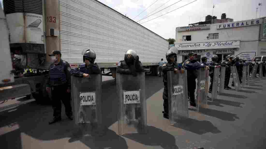 Sept. 1, 2010: Police stood guard by a truck containing some of the bodies of immigrants killed by members of the Zetas drug cartel in Tamaulipas state.