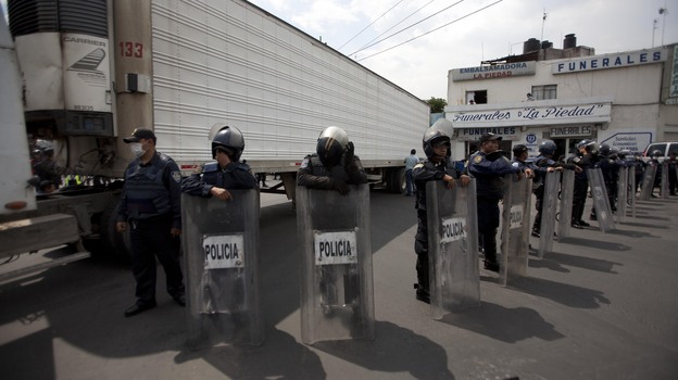 Sept. 1, 2010: Police stood guard by a truck containing some of the bodies of immigrants killed by members of the Zetas drug cartel in Tamaulipas state. (Xinhua /Landov)