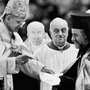 Pope Paul VI hands Orthodox Metropolitan Meliton of Heliopolis a decree during the December 1965 session of the Roman Catholic Ecumenical Council in Vatican City. The decree cancels excommunications that led to the break between the Roman and Orthodox churches nine centuries before.