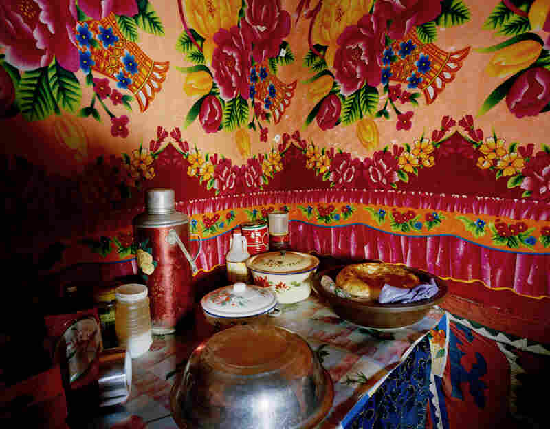 The kitchen inside Jimira's mountain home. Naan and mutton are part of the staple diet of Kyrgyz nomads. There is no running water and no electricity. Firewood stoves are used for cooking and for heating the space.