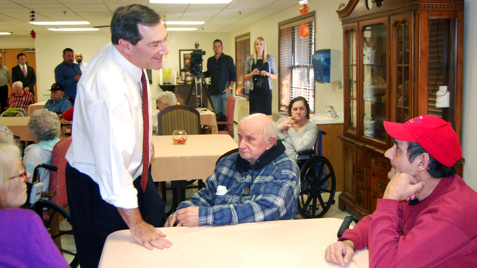 U.S. Rep. Joe Donnelly of Indiana talked with residents of Columbia Healthcare Center, a nursing home in Evansville, Ind., on Thursday. (NPR)
