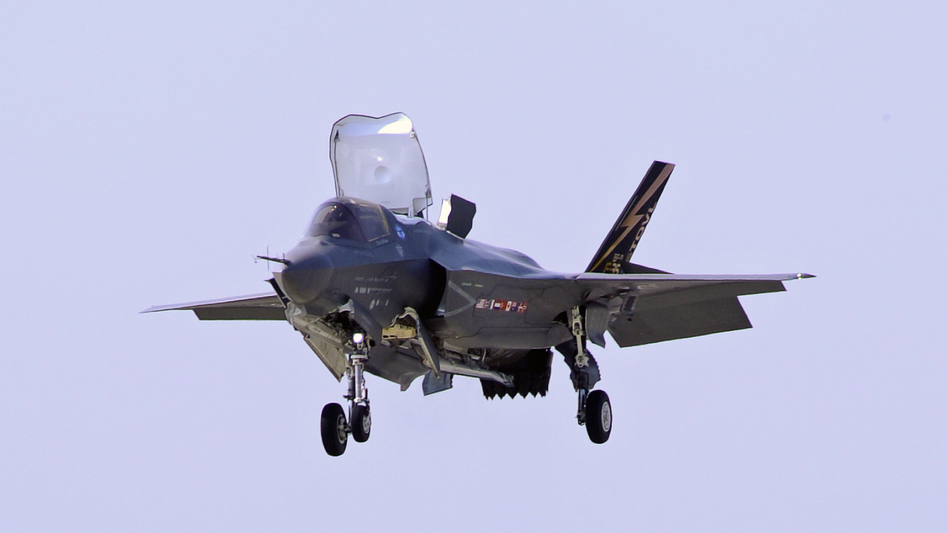 A Marine Corp F-35B Joint Strike Fighter lands at Patuxent Naval Air Station in Maryland in 2011. Analysts say that if mandatory Pentagon budget cuts are imposed next year, fewer new planes could ultimately be ordered. (AP)