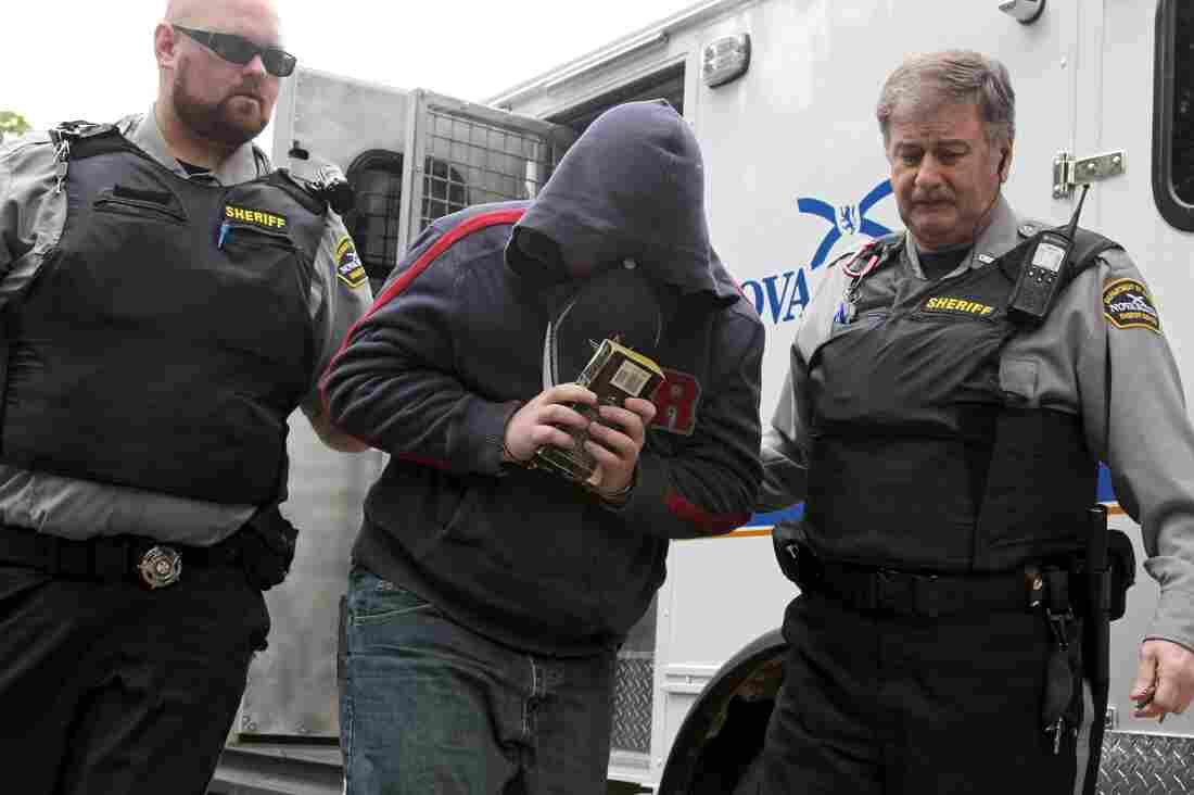 Sub.-Lt. Jeffrey Delisle is escorted into Nova Scotia provincial court in Halifax in June.