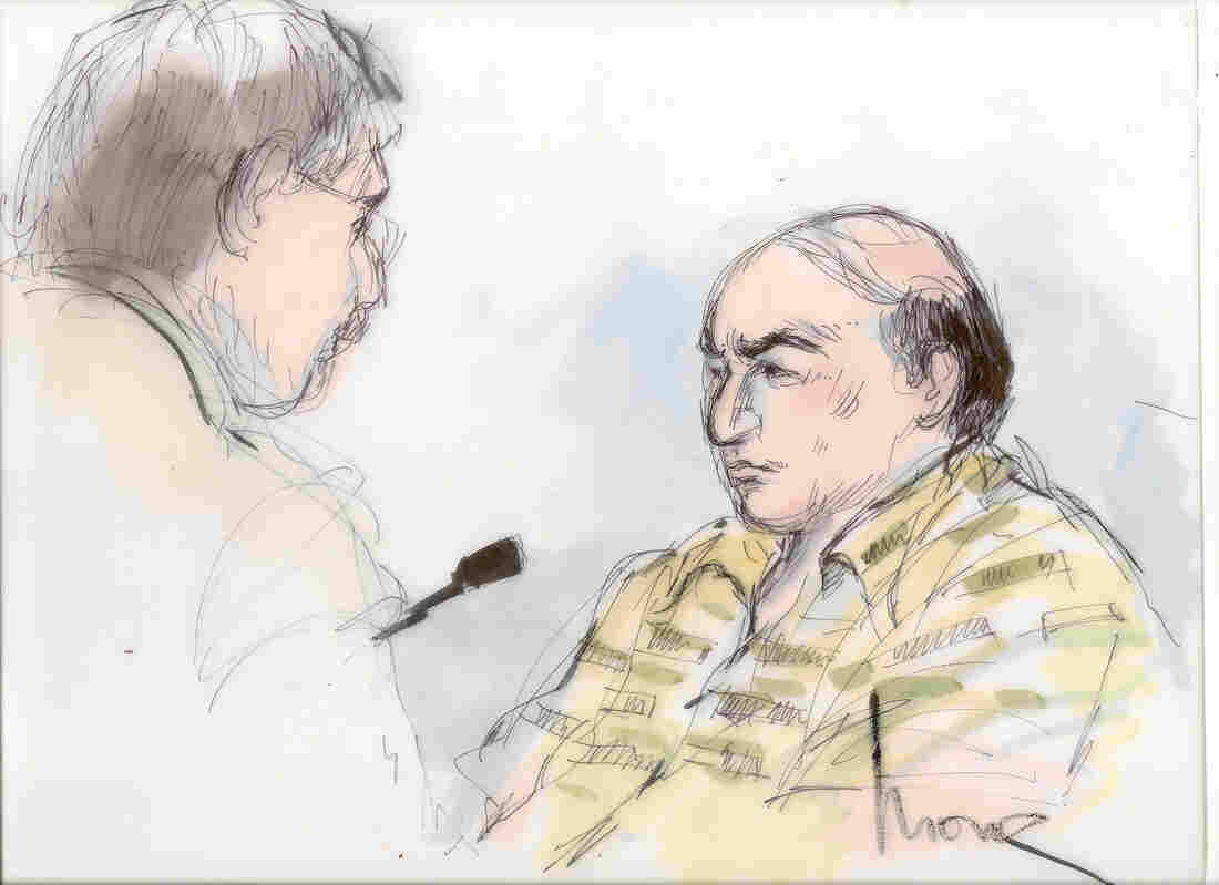 This Sept. 27, file courtroom sketch shows Mark Basseley Youssef, right, talking with his attorney Steven Seiden in court.