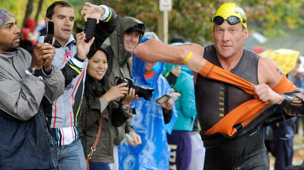 Lance Armstrong competes in the Rev3 Half Full Triathalon Sunday in Ellicott City, Md. Armstrong joined other cancer survivors in the event, which raised funds for the Ulman Cancer Fund for Young Adults. (AP)