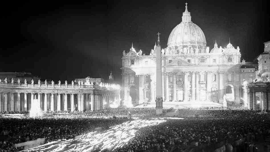 Thousands of faithful Catholics carry torches in a procession in St. Peter's Square in Vatican City on Oct. 11, 1962, the opening day of the historic Second Vatican Council. Over a three-year period, more than 2,000 bishops from around the world issued 16 landmark documents, which championed a more inclusive, less hierarchical and open church.