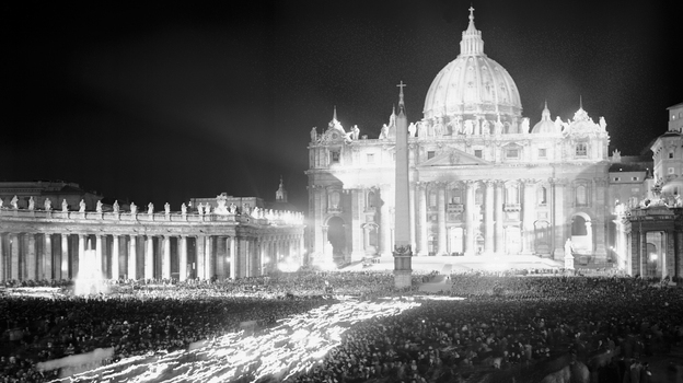 Thousands of faithful Catholics carry torches in a procession in St. Peter's Square in Vatican City on Oct. 11, 1962, the opening day of the historic Second Vatican Council. Over a three-year period, more than 2,000 bishops from around the world issued 16 landmark documents, which championed a more inclusive, less hierarchical and open church. (AP)