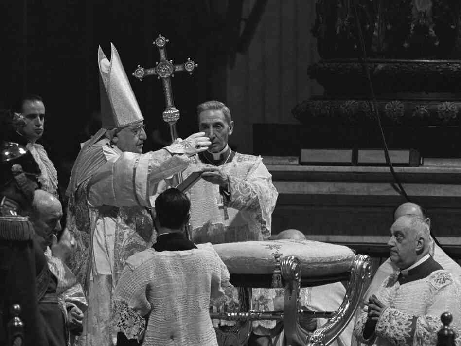Pope John XXIII waves a hand in blessing during the opening day of Vatican II, on Oct. 11, 1962. The newly elected pope surprised many Catholics by convening the gathering, the first of its kind in nearly a century.