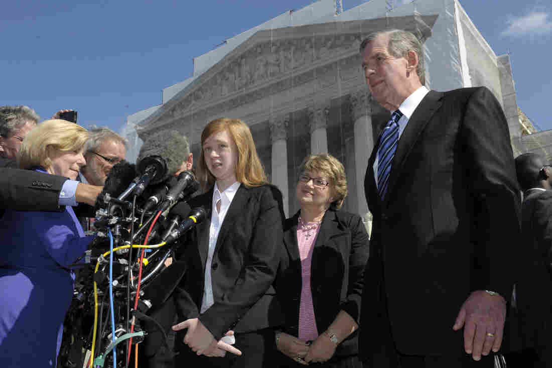 Abigail Fisher, the Texan involved in the University of Texas affirmative action case, talks to reporters outside the Supreme Court in Washington on Wednesday.