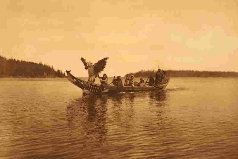 "The book caption reads: "" ... a masked [Kwakiutl] man personating the thunderbird, dances with characteristic gestures as the canoe approaches the bride's village."""