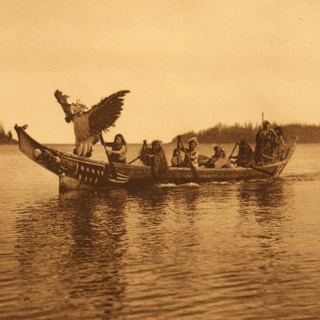 "The caption for this photo in Edward Curtis' book reads: "" ... a masked [Kwakiutl] man personating the thunderbird, dances with characteristic gestures as the canoe approaches the bride's village."""