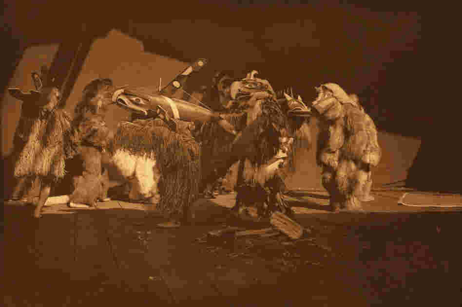 "In his book, Curtis identifies this as a Kwakiutl ""group of winter dancers."" Curtis (and later, his team of photographers) had unprecedented access to sacred ceremonies."