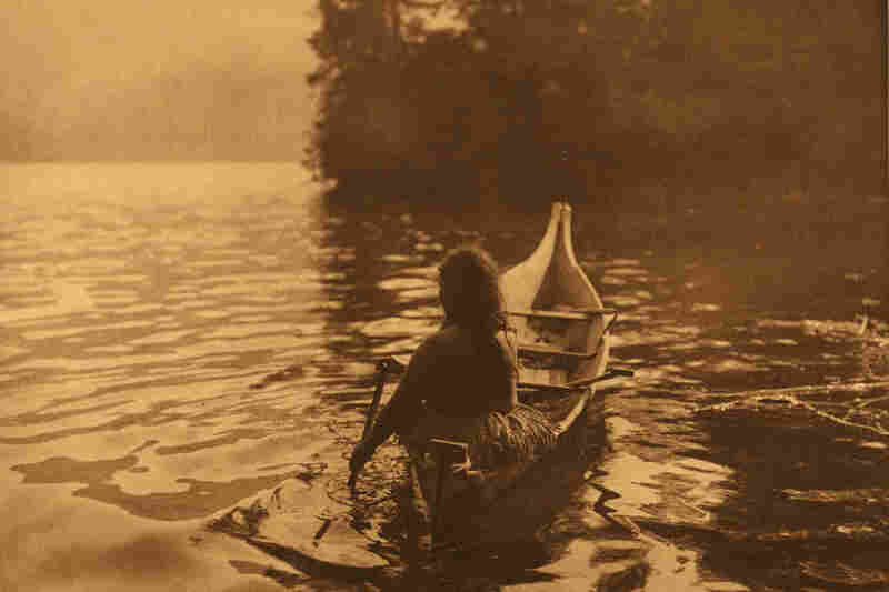 """A [Clayoquot] medicine-woman, alone is seeking a solitary place in which to perform her rites of bodily purification ... "" reads the Curtis caption."