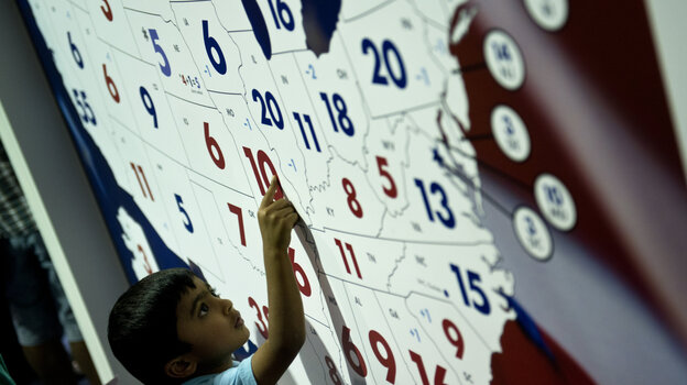 A boy examines CSPAN's 2012 presidential race electoral map at the American Presidential Experience exhibit last month in Charlotte, N.C. (AFP/Getty Images)