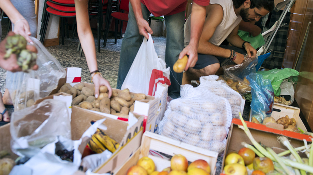 In June, people in Madrid came to a distribution center where those in need could get food. (AFP/Getty Images)