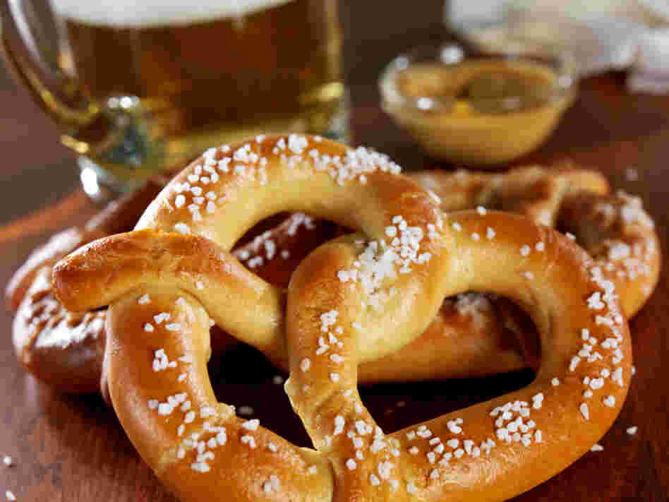 Taking a bite out of a salty pretzel can actually enhance the bitterness of your beer. That's one reason pretzels and beer work as a pair.