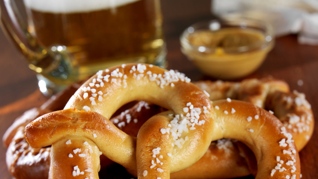 Taking a bite out of a salty pretzel can actually enhance the bitterness of your beer. That's one reason pretzels and beer work as a pair. (iStockPhoto)