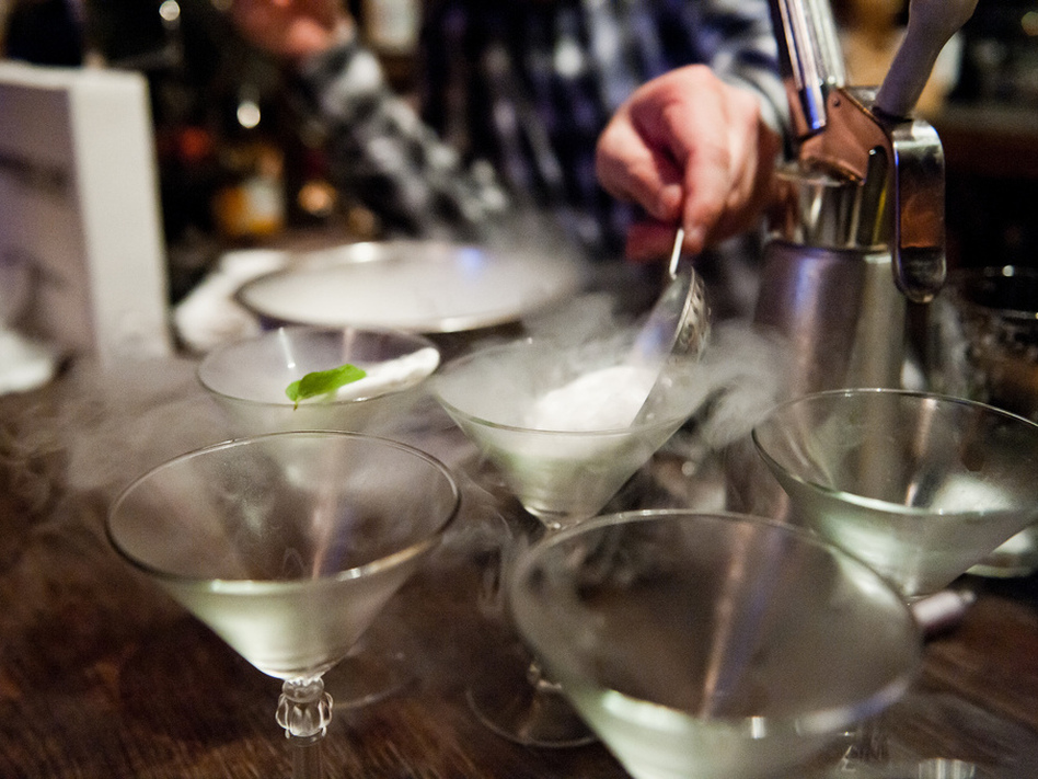 A bartender prepares cocktails using liquid nitrogen at Bourbon and Branch in San Francisco.