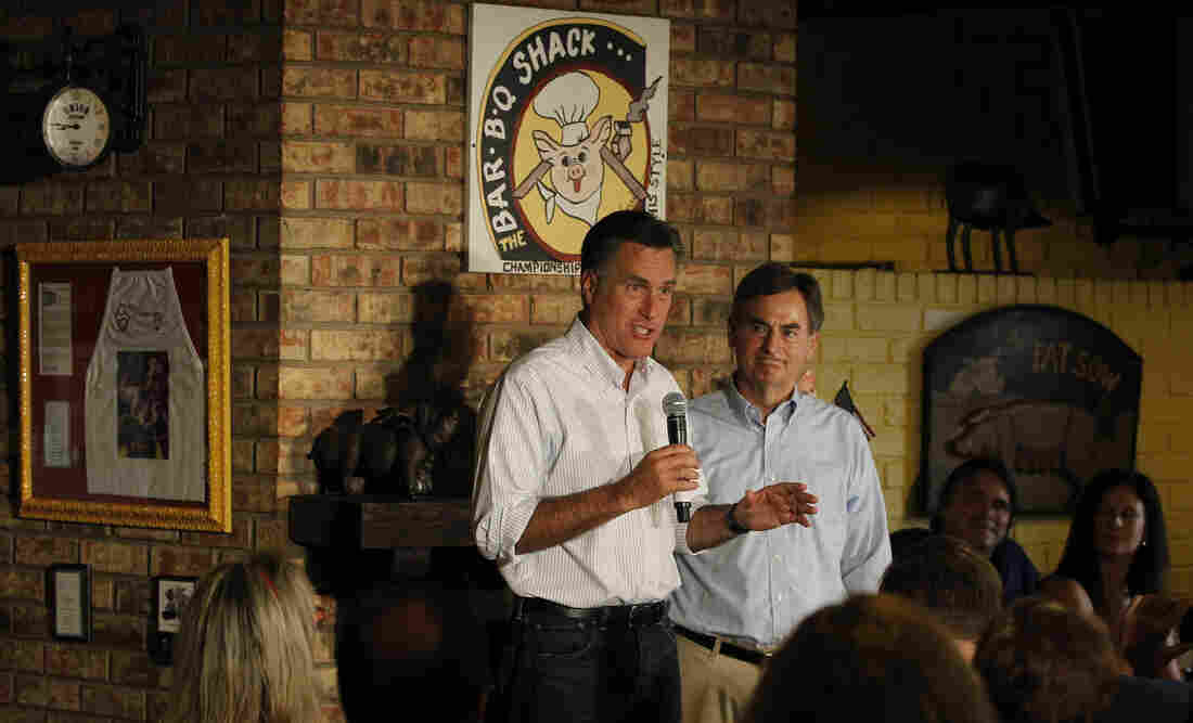 Republican presidential candidate Mitt Romney stumped for U.S. Senate hopeful Richard Mourdock (right) in August at Stepto's BBQ Shack in Evansville, Ind.