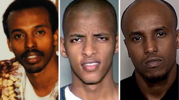 Abdifatah Yusuf Isse (center) and Salah Osman Ahmed (right) are among more than 20 young men who left Minnesota since 2007 to join al-Shabab. They are testifying against Mahamud Said Omar (left), who is accused of helping to send fighters and money to the al-Qaida-linked group in Somalia. (AP)