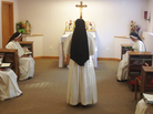 A nun chants while she and her sisters pray together during Vespers at their home near Dumfries, Va. Unlike older sisters shaped by Vatican II, a new generation of women are flocking to more conservative orders.